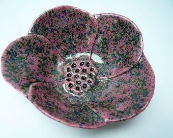 Cup black speckled pink flower