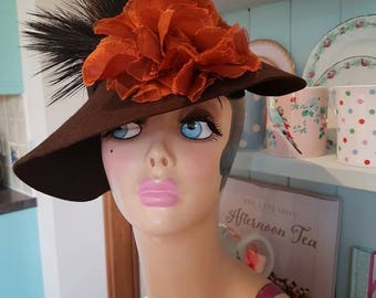 1940s felt hat embellished with a stunning flower and feather