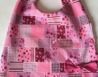 Pink patchwork bib with snap
