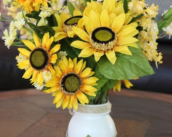 Large mason jar filled with sunflowers and wildflowers