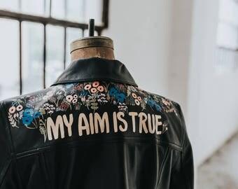 "Hand-Painted Vintage Leather Jacket: ""My Aim Is True"""