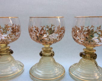 Set of three antique roemer wine glasses decorated by hand with enamelled gold, blue and white flower decoration, Theresienthal glass