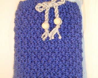 Hot-water bottle and knitted coat in blue winter
