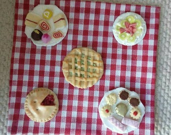 Hand made 1/12th scale dolls house cakes and pies.