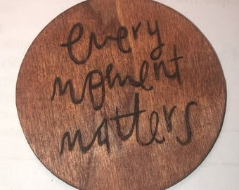 Every moment matters wood burned magnet