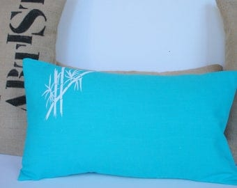 Rectangular cushion, washed linen turquoise blue, custom bamboo branches cover
