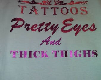 Tattoos pretty eyes and thick thighs