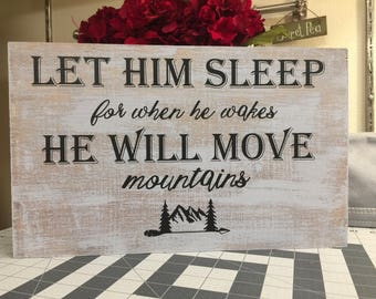 Let him sleep for when he wakes he will move mountains wood sign