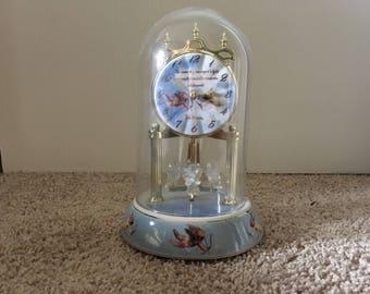 Clock with rotating cherubs