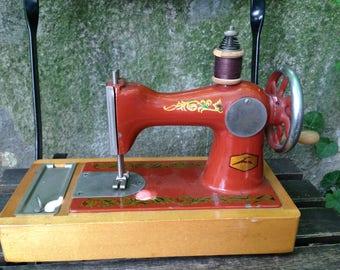 Vintage Russian hand-crank child's sewing machine. Collectables/Soviet era/Children's toys.