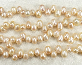 x30 Natural Cultured freshwater pearls apricot pink in drop / oval shape for bracelet necklace (#AC517)