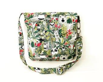Crossbody Shoulder Messenger Handbag with adjustable strap magnetic closure and 2 slip pockets.