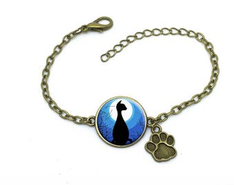 """Bracelet bleu et noir """" chat au clair de lune """", image sous cabochon résine ,monture couleur bronze,ref bA 47"""