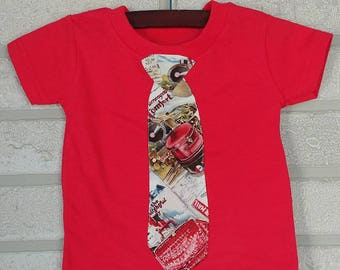 Kids suitcase tie on a red t shirt