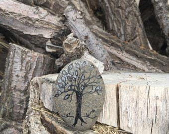 Hand painted tree on rock