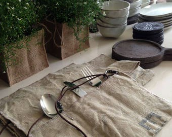 Set of 2 sturdy cutlery cases and 2 matching placemats by vintage postbags.
