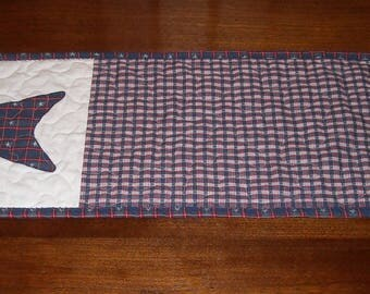 "New, quilted, patriotic table runner/wall hanging. 10"" x 29 1/2"", Red, white, and blue with applique plaid star."