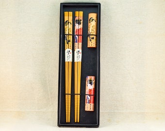 Set of two bamboo chopsticks and stands with classic Japanese art. Vintage Japanese chopsticks.