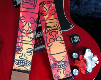 Stylish tiki guitar strap -- shades of red, orange and black