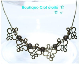Mid-length bronze necklace arabesque