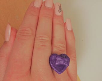 Heart ring with a bow with purple polymer clay.