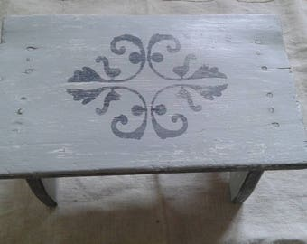 Small cloud gray weathered bench and gunmetal