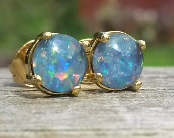 Natural Australian opal stud earrings in 14k over 925