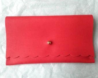 Red leather, gold clasp clutch