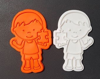 Boy holding a Puzzle Piece  Cookie Cutter and Stamp