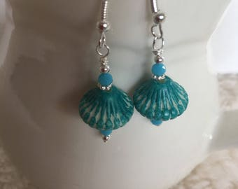 Turquoise dangle earrings with turquoise crystals. Turquoise drop earrings. Turquoise crystals and silver embellishment.