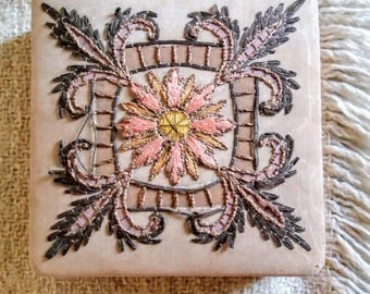 Antique floral embroidered jewelry box .