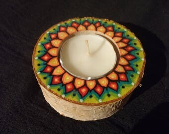 Candle holder decorated with raw wood flower orange on lime green
