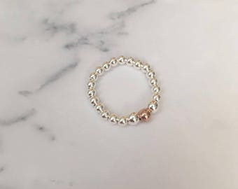 Sterling Silver stretch ring with Rose Gold Filled bead.