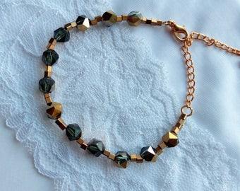 Bracelet beads crystals gold green.