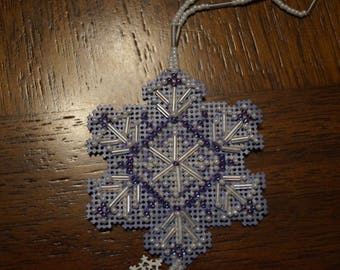 lavender and white handmade beaded snowflake
