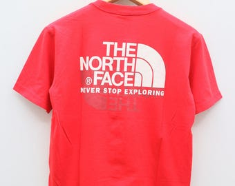Vintage THE NORTH FACE Never Stop Exploring Red Tee T Shirt Size S