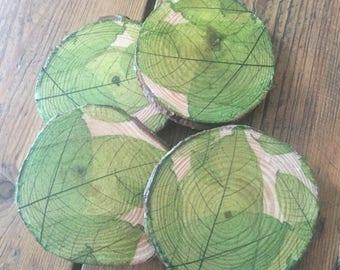 Rustic log slice coasters with decoupaged leaf design