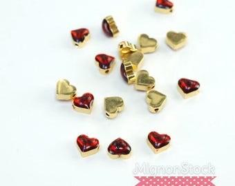 """Destash"" small charm - brass, red gold - (Dimensions: 7 x 7 x 4 mm)"
