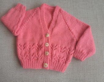 Hand knitted baby girls cardigan