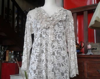 dress has ruffled tunic all in beige lace