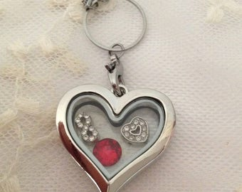 Heart necklace with floating charms.