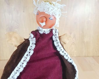 An old doll - Old Tramp Hand Puppet - Theater doll.