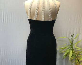Crazy cute late 80's/early 90's Black crushed velvet halter dress with cascading pearl back.
