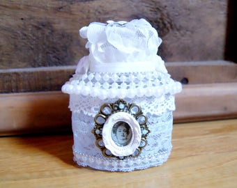 Decorative perfume bottle in blue and white lace