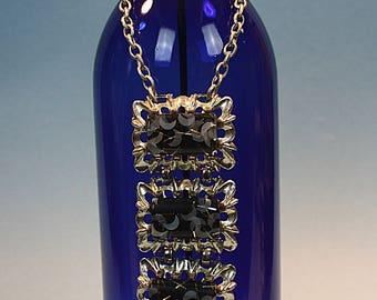 Cobalt blue burner adorned with triple pendants