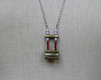 beaded handmade purple, red, and bronze long statement necklace
