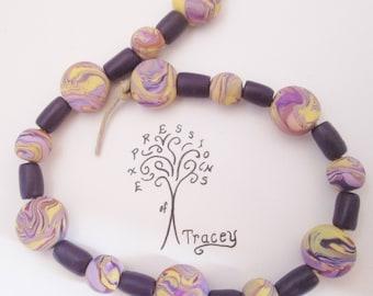 Handmade Yellow and Purple Swirl Polymer Clay Beads