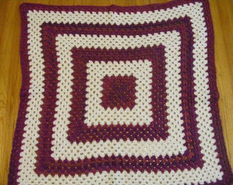 Plush burgundy and white granny square afghan