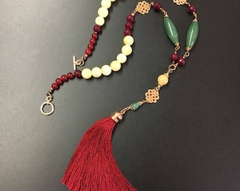 Necklace of gemstones and tassel