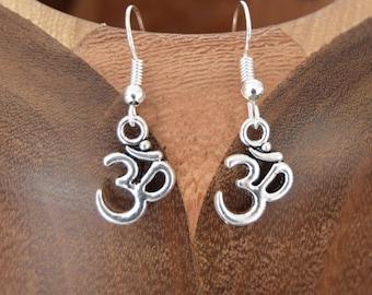 OM, OM clips Silver earrings